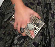 Kelly Osbourne stashed her party essentials in a gold metal clutch.