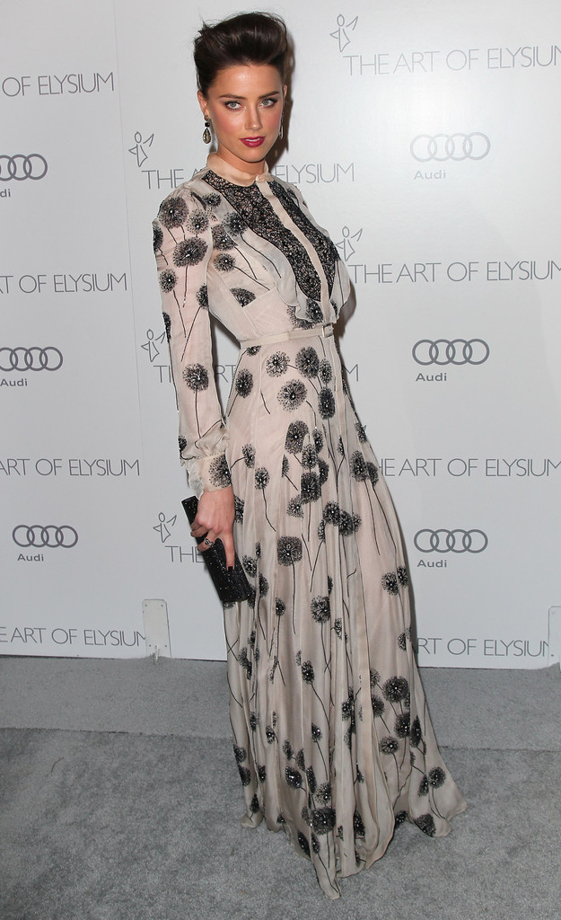 "Actress Amber Heard attends the Art of Elysium&squot;s 6th Annual Black-tie Gala ""Heaven"" at 2nd Street Tunnel on January 12, 2013 in Los Angeles, California."