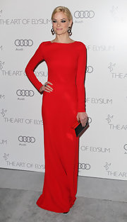 Jaime looked scandalous yet modest in this long-sleeve fiery red gown at the Art of Elysium's gala.