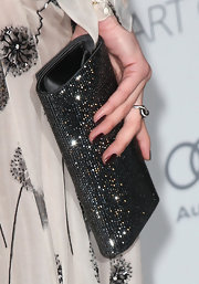 Amber Heard posed for photos with a rhinestone-studded black satin clutch.