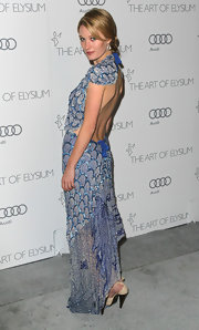 Ashley Hinshaw looked like a piece of art in this draped blue beaded evening dress with a stunning open back.