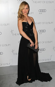 Mena Suvari brought on the drama at the Art of Elysium Heaven Gala in this black strapless chiffon gown.