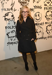 Rachael Harris opted for a black belted trench coat to complete her look at the Pieces of Heaven event in LA.
