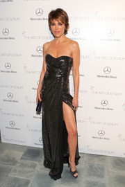 Lisa Rinna flaunted some leg at the Art of Elysium's Heaven Gala in a strapless black House of Ronald gown with a thigh-high slit.
