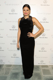 Melonie Diaz donned a very classy black Marchesa column dress with a lace-embellished bodice for the Art of Elysium's Heaven Gala.