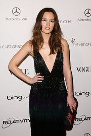 Leighton Meester added feminine flair to her flapper style with a glittery Louis Vuitton Spring 2011 floral print clutch.