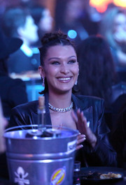 Bella Hadid accessorized with a silver link necklace by Chrome Hearts at the Art of Elysium event.