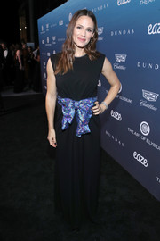 Jennifer Garner donned a sleeveless black Gucci gown with an iridescent bow belt for the Art of Elysium Heaven celebration.
