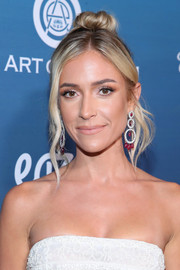 Kristin Cavallari styled her hair into a top knot with wavy tendrils for the Art of Elysium Heaven celebration.