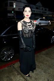 62d99d31a0f Dita Von Teese attended the Art of Elysium Heaven celebration wearing a  black Jenny Packham gown