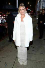 Kristin Cavallari arrived for the Art of Elysium Heaven celebration wearing a white Apparis faux-fur coat over a matching column dress.