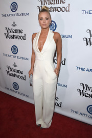 Kaley Cuoco was sharp and sexy in a low-cut white tux-style jumpsuit at the Heaven Gala.