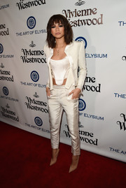 Zendaya Coleman teamed a sleek white pantsuit with a racy corset top for the Heaven Gala.