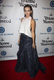 Camilla Belle paired her top with a floor-length floral-threadwork skirt, also by Carolina Herrera.