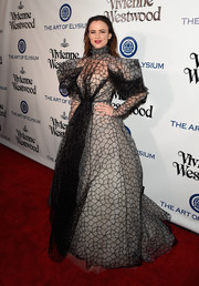 Juliette Lewis was a scene stealer at the Heaven Gala in a voluminous Vivienne Westwood Couture gown rendered in sheer black fabric with puffed sleeves and a white underlay.