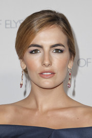 Camilla Belle finished off her makeup with a glossy lip.