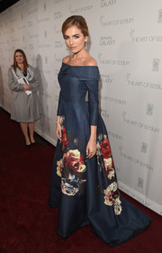 Camilla Belle was the picture of pure romance at the Art of Elysium Heaven Gala in a blue Carolina Herrera off-the-shoulder ballgown featuring a gorgeous floral print on the skirt.