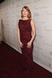 Alicia Witt opted for a modest red lace gown when she attended the Art of Elysium Heaven Gala.