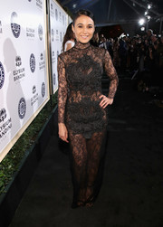 Emmanuelle Chriqui was a sexy standout at the Art of Elysium Heaven Gala in a sheer black lace gown by Thai Nguyen Atelier.