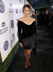 Kat Graham put her cleavage on display in a low-cut off-the-shoulder LBD at the Art of Elysium Heaven Gala.