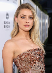 Amber Heard went for edgy styling with this messy side-parted style at the Art of Elysium Heaven Gala.