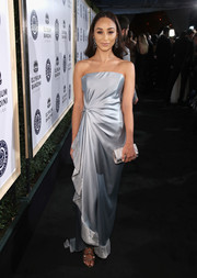 A silver chainmail clutch rounded out Cara Santana's high-shine look.