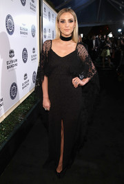Ashlee Simpson went for bohemian glamour in a caped black gown by Grace Loves Lace that she wore with Sylva & Cie jewelry at the Art of Elysium Heaven Gala.