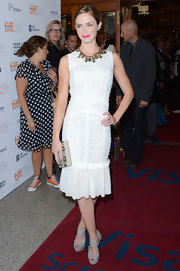 Emily Blunt stunned in a simple white sleeveless dress that featured ruched detailing and a flared skirt.