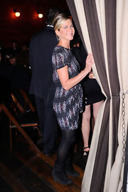 At the Artists for Haiti dinner in NYC, Jen donned a chic print dress paired with black tights and black suede boots.