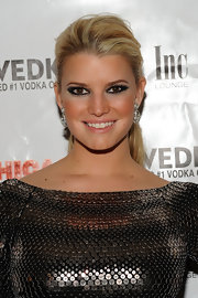 Jessica Simpson added a dash of sass to her sequin dress with a smoky eye. She opted for an otherwise natural look.
