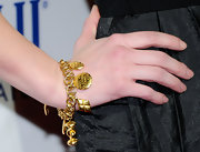 Actress Ashley Green added a gilded touch to her look with a golden charm bracelet.