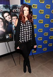 Ashley wears a unique cardigan with shoulder cut outs for her movie signing at Best Buy.