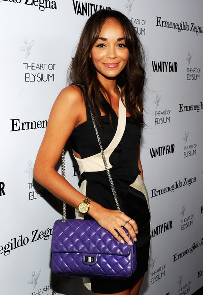 Ashley Madekwe Gold Chronograph Watch [clothing,shoulder,fashion,dress,cocktail dress,fashion design,little black dress,style,fashion accessory,black hair,ashley madekwe,documentary film project,california,beverly hills,ermenegildo zegna,art of elysium,vanity fair,la event]