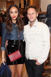 Ashley Madekwe styled her denim shirt and mini skirt combo with a red Chanel shoulder bag when she attended the launch of 7 for All Mankind x Malhia Kent.