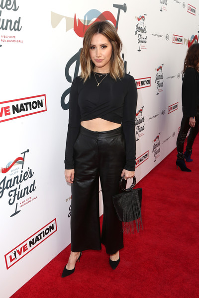 Ashley Tisdale Metallic Purse [clothing,red carpet,carpet,flooring,joint,shoulder,premiere,crop top,footwear,waist,steven tyler,ashley tisdale,california,los angeles,live nation,inaugural janies fundgala grammy viewing party,red studios,gala benefitting janies fund]
