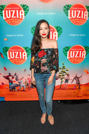 Christian Serratos completed her casual ensemble with nude ballet flats.