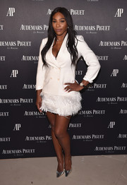 Serena Williams dolled up her jacket with a feathered mini skirt by BCBG Max Azria.