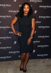 Serena Williams donned a fitted, cap-sleeve LBD with side cleavage-flashing lace panels for the Audemars Piguet Rodeo Drive grand opening.