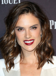 Alessandra Ambrosio chose a striking red hue for her lips.
