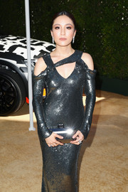Constance Wu matched a metallic box clutch with a gunmetal sequined gown for the 2018 Emmy Awards.