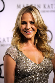 Julie Benz attended the Audi 2012 Golden Globe Awards celebration wearing her long hair in loose curls.