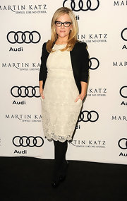 Rachael Harris topped off her look with black tights and patent leather platform pumps.