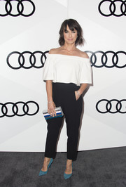 Constance Zimmer punctuated her black-and-white look with teal suede pumps by Tamara Mellon.