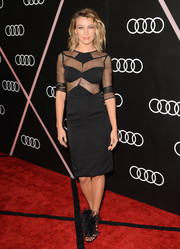 Natalie Zea teamed her LBD with Gucci feather sandals for a totally fab look.