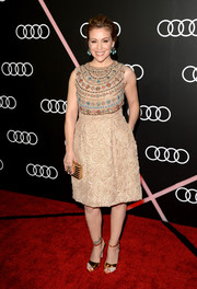 Alyssa Milano added shimmer to her look with a pair of gold evening sandals.