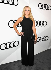 Emily Osment complemented her outfit with a beaded black satin clutch by Kate Spade.