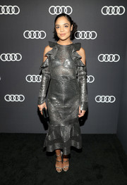 Tessa Thompson went for full-on shine with a pair of silver Giuseppe Zanotti sandals.