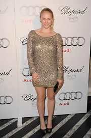 Leven Rambin wore a gold ring embellished with dangling pearls and crystals from the New Pearl collection.