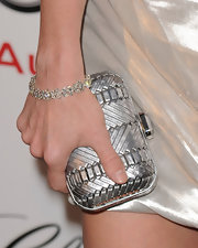 Jayma paired her silver draped dress with a stunning box clutch.