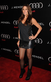 Sofia Vergara was sassy in a pair of black cutout boots. The heels toughened up her sequined mini skirt.